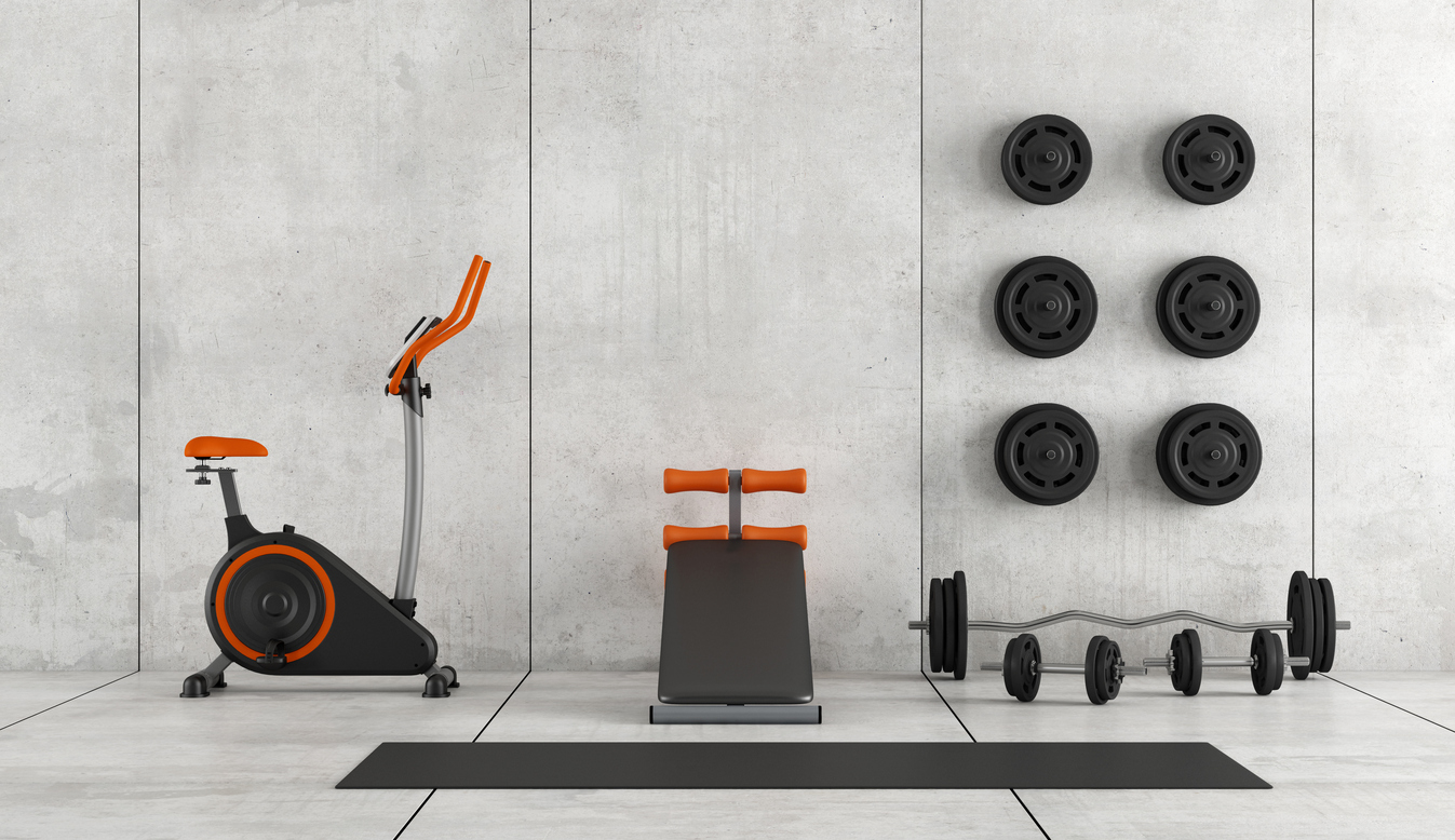 Concrete room with stationary bike, abdominal bench and weight - 3d rendering